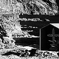 small shrine with cross made out of sea shells on rocky coastline at punta de teno Tenerife Canary Islands Spain by Joe Fox