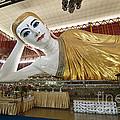 Smiling Reclining Buddha In Yangon Myanmar by Juergen Ritterbach