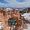 Snow Capped Arch At Bryce by Evie Carrier