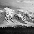 snow covered landscape of anvers island mountain range and neumayer channel Antarctica by Joe Fox