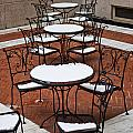 Snow Covered Patio Chairs And Tables by Thomas Marchessault