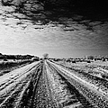 snow covered untreated rural small road in Forget Saskatchewan Canada by Joe Fox