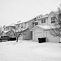 snow falling in residential street during winter Saskatoon Saskatchewan Canada by Joe Fox