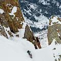 Snowboarder Doing A Slash by Brandon Huttenlocher