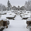 Snowfall At Longview Mansion by Dennis Hedberg