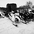 snowmobiles parked in Kamsack Saskatchewan Canada by Joe Fox