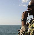 Soldier Instructs Small Boat Maneuvers by Stocktrek Images