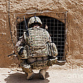 Soldier Searches A Compound by Stocktrek Images