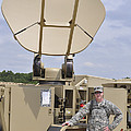 Soldier Stands Next To A Satellite by Stocktrek Images