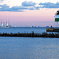 Southeast Guidewall Lighthouse At Sunset And Tall Ship Windy by Sally Rockefeller