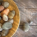 Spa Rocks In Wooden Bowl On Rustic Wood by Sandra Cunningham