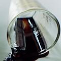 Spilled Balsamic Vinegar by Romulo Yanes