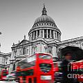 St Pauls Cathedral In London Uk Red Buses In Motion by Michal Bednarek