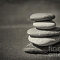 Stacked Pebbles On Beach by Elena Elisseeva