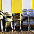 Stacks Of Chairs And Tables by Carlos Caetano