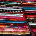 Stacks Of Colorful Shawls by Robert Hamm