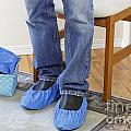 Standing Person Wearing Booties by Lee Serenethos
