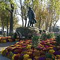 Statue And Flower Bed Across The Street From The Grand Palais Off Of Champs Elysees by Richard Rosenshein