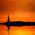 Statue Of Liberty At Sunset by John Farnan
