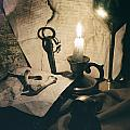 Still Life With Bones Rusty Key Wine Glass Lit Candle And Papers by Jaroslaw Blaminsky