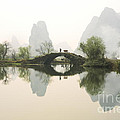 Stone Bridge In Guangxi Province China by King Wu