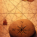 Stone Compass On Old Map by Garry Gay