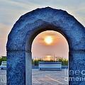 Sunrise Through The Arch - Rehoboth Beach Delaware by Kim Bemis