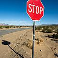 Stop Sign On Indian Ranch Road In Death Valley by Alyaksandr Stzhalkouski