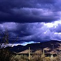 Storm Clouds In The Desert by L L Stewart