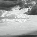 Storm Light On The Desert by Roupen  Baker