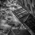 Stormy Clouds Over Modern Building by Gareth Burge Photography