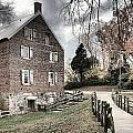 Stormy Skies Over The 1823 Grist Mill by Adam Jewell