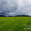Stormy Sky Above Castlerigg Stone Circle by Louise Heusinkveld