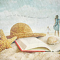 Straw Hat And Book In The Sand by Sandra Cunningham