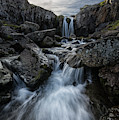 Stream Flows Over A Waterfall by Robert Postma