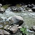 Stream Water Foams And Rushes Past Boulders by Imran Ahmed