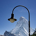 Street Lamp And Mountain by Mats Silvan