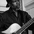 Street Musician Black And White by Jon Cody