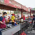Street Restaurant In Phnom Penh Cambodia by Jacek Malipan