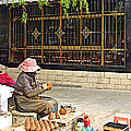Street Shopkeeper In Lhasa-tibet by Ruth Hager