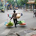 Streets Of Hanoi by Chuck Kuhn