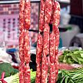 String Of Handmade Sausages by Yali Shi
