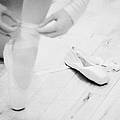 Student Putting On Pointe Shoes At A Ballet School In The Uk by Joe Fox