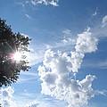Sun And Cloudburst by James Potts