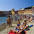 Sun Bathers In Sestri Levante In The Italian Riviera In Liguria Italy by David Smith