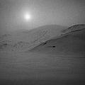 sun breaking through white out snowstorm whalers bay deception island Antarctica by Joe Fox