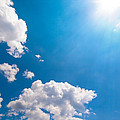 Sun Burst On A Blue Sky And Clouds by Leyla Ismet