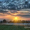 Sun Rays Vs Rain Clouds by Michael Ver Sprill