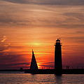 Sun Set At The Muskegon Lighthouse by John Harmon