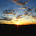 Sun Setting Behind The Mountains by Darren Burton
